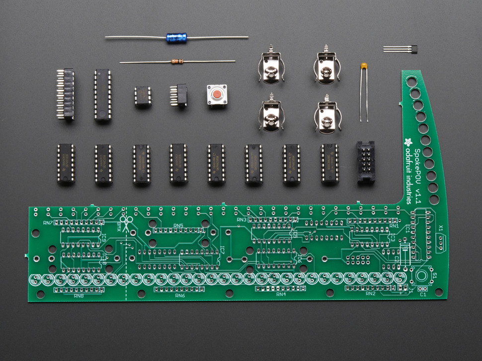 Layed-out collection of all kit components - PCB and loose parts.