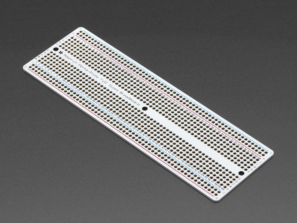 Angled shot of Adafruit Perma-Proto Full-sized Breadboard PCB.