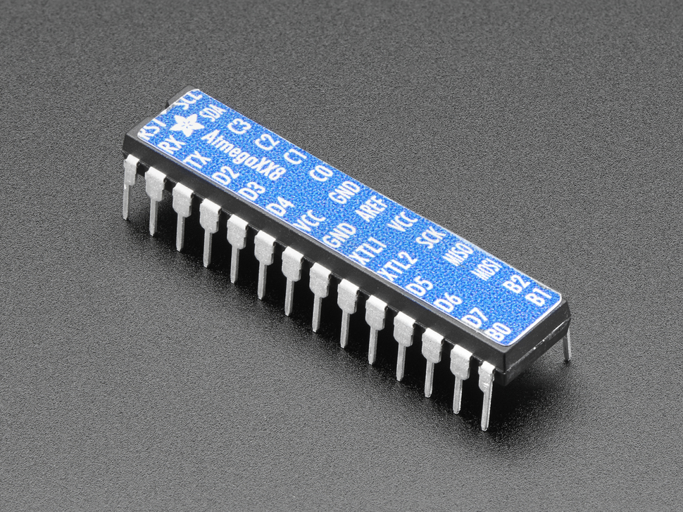 Adafruit AVR ATmegaXX8 Pinout Sticker displayed on a chip