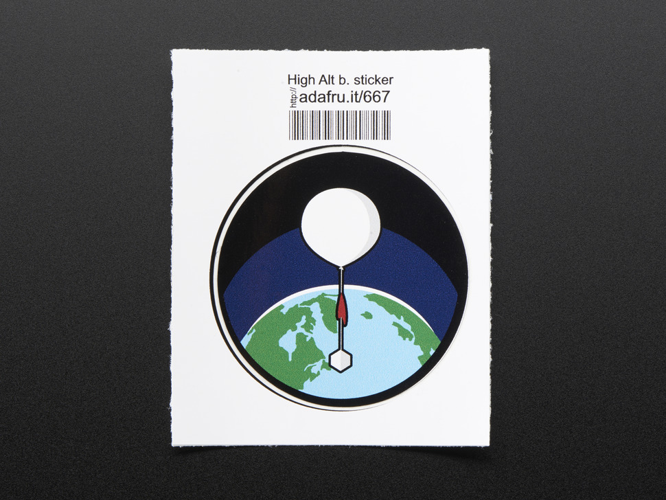 Circular sticker with white high altitude balloon over a green and blue earth on a black background, with black trim. Mounted on white paper with barcode.