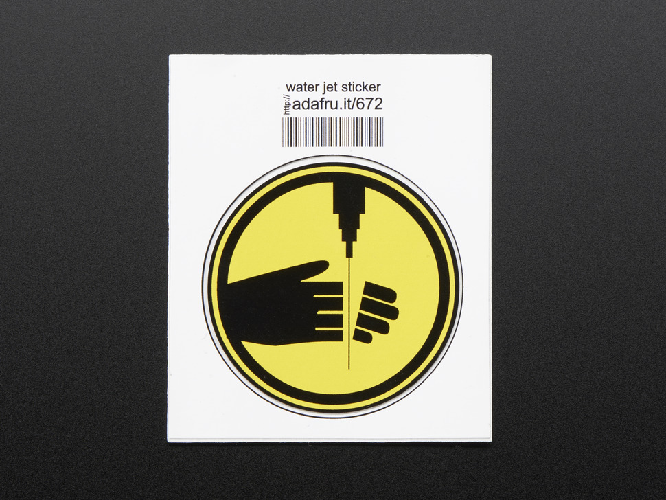 Circular sticker showing left hand with fingers severed by water pick, in black on yellow background, with black edge.  Mounted on white paper with barcode