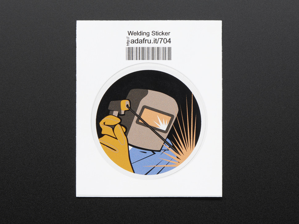 Circular sticker showing the bust of an active welder in grey mask, orange safety gloves and blue coveralls with a corona of radiating orange sparks, over a black background. Sticker is edged in white and mounted on white paper with barcode