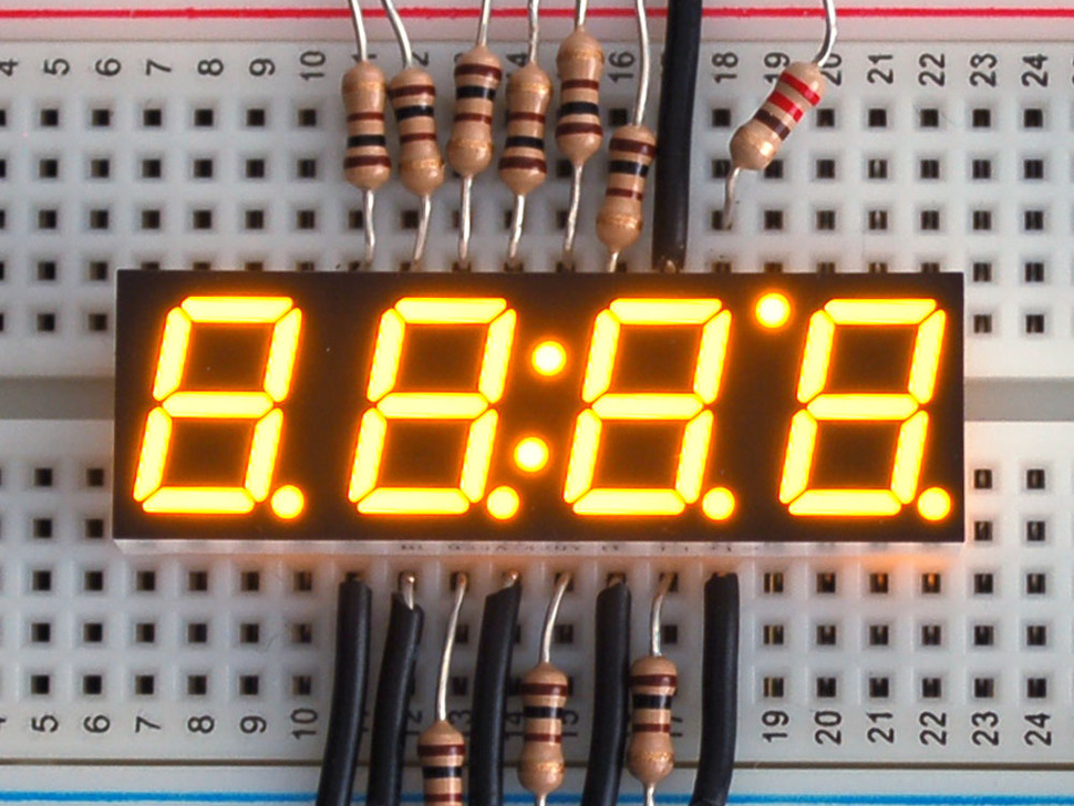 Small yellow 7-segment clock display with all segments lit