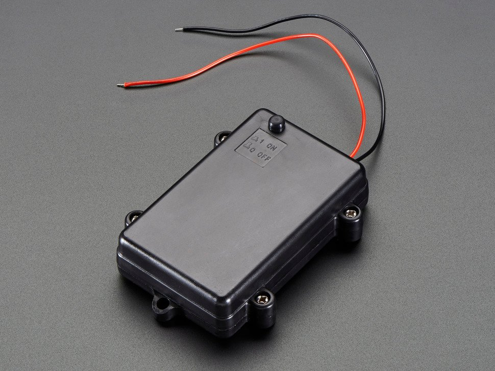 Angled shot of black 3 x AA waterproof battery holder with plain wires.