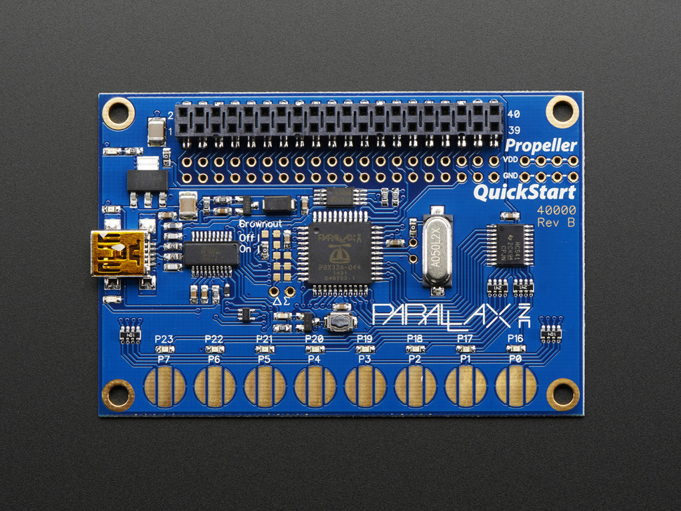 Top-down showing Propeller chip, capacitive touch pads, breakout headers and USB port.