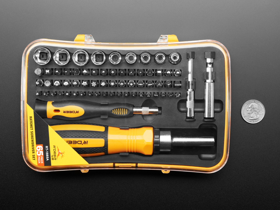 Top down of screwdriver kit with two handles and many tips and sockets