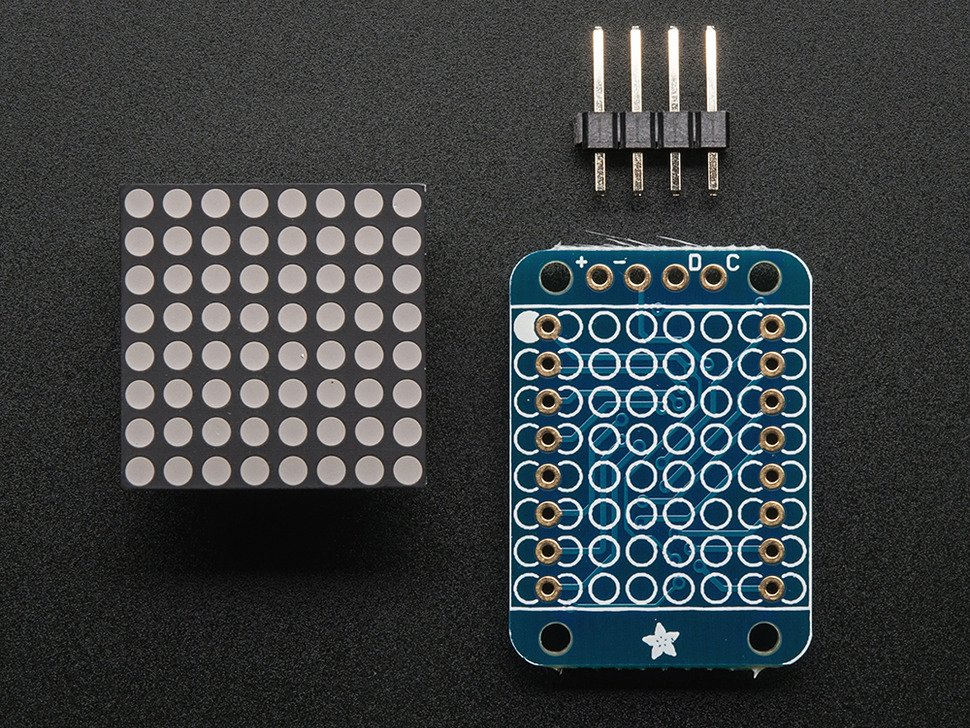 Front of 8x8 Yellow LED Matrix. Powered off. Backpack and headers shown.