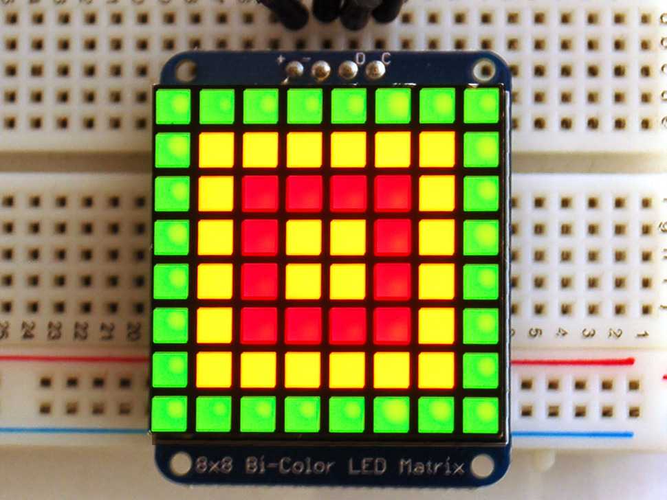 Assembled I2C backpack with LED square plugged into a breadboard.