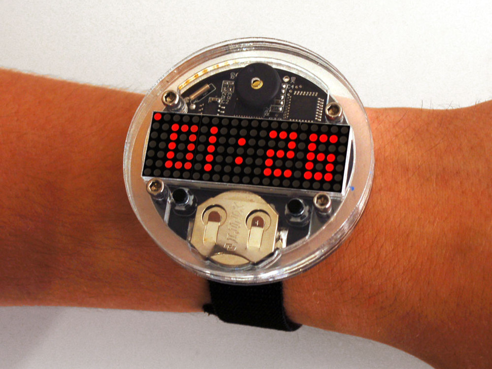 Arm with large round watch with dot matrix display showing time