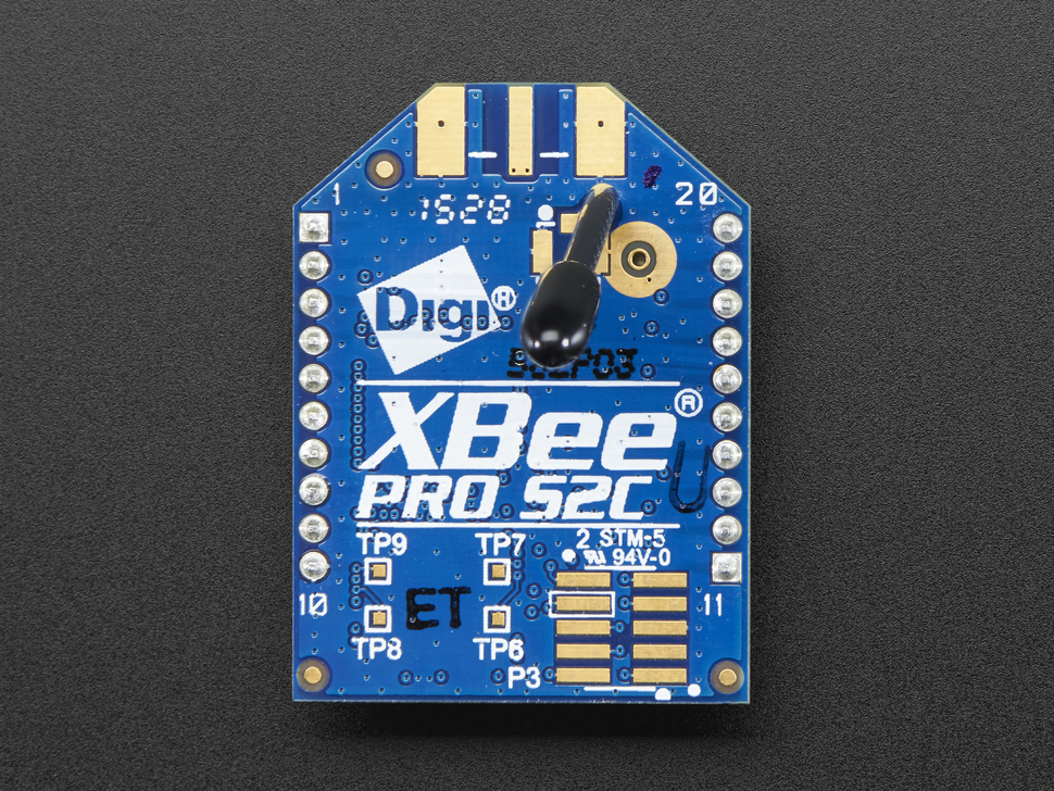 Top of XBee PRO S2C wireless module showing antenna and spot for SMA connector.