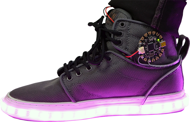 Side view of a shoe with an Adafruit FLORA board attached and LED light strip around the bottom glowing purple