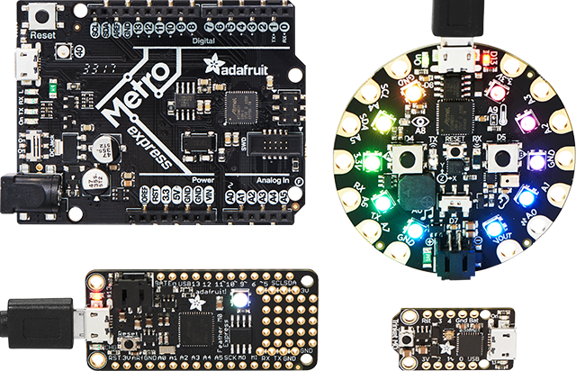 Top view of an Adafruit Metro, Circuit Playground, Feather, and Trinket