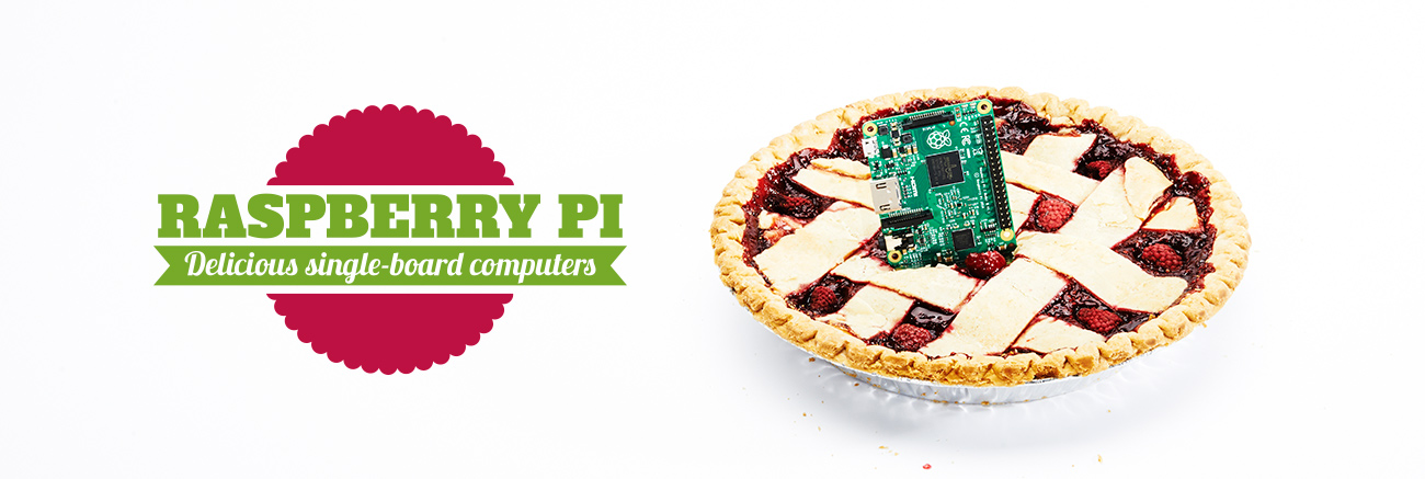 Raspberry Pi. Delicious single-board computers. A green computer board sticking up in the middle of a raspberry pie.