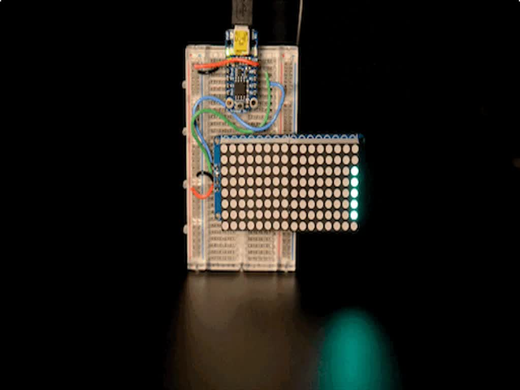 """Soldered and assembled 16x8 1.2"""" LED Matrix + Backpack - Ultra Bright Round Green LEDs on a breadboard powered by a trinket. The LED Matrix displays the rolling text: """"Adafruit"""""""