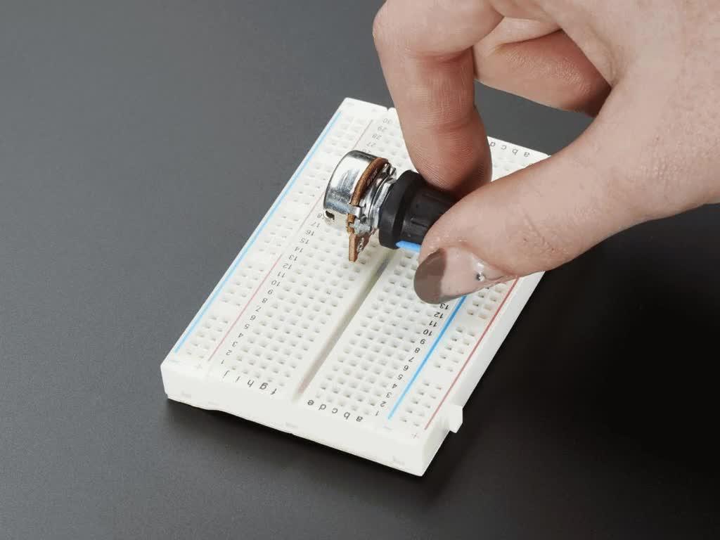 Hand turning knob on potentiometer