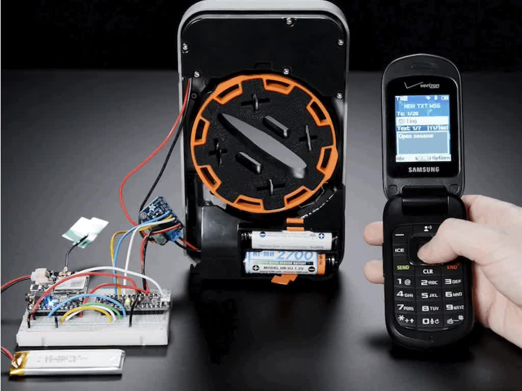 Lockitron Motorized Door Lock Body being opened by cell phone project on breadboard
