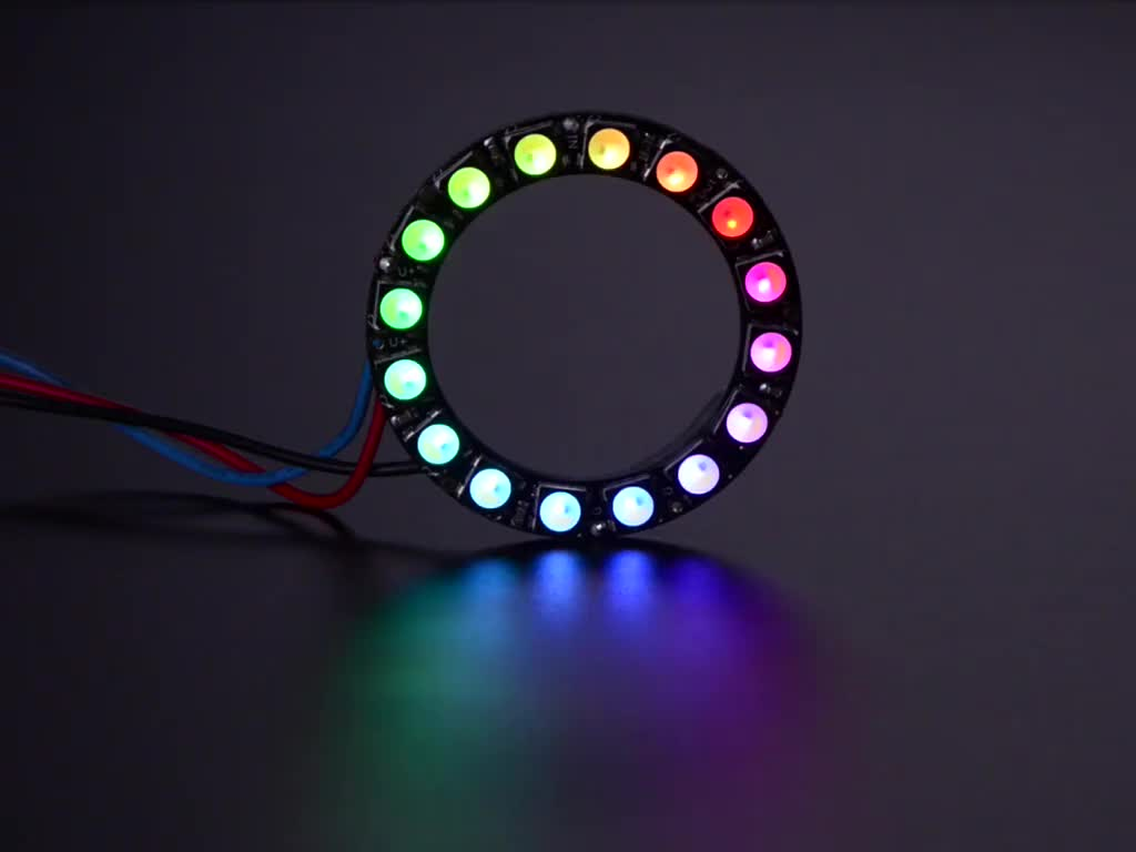 NeoPixel Ring with 16 x 5050 RGBW LEDs lighting up rainbow and white