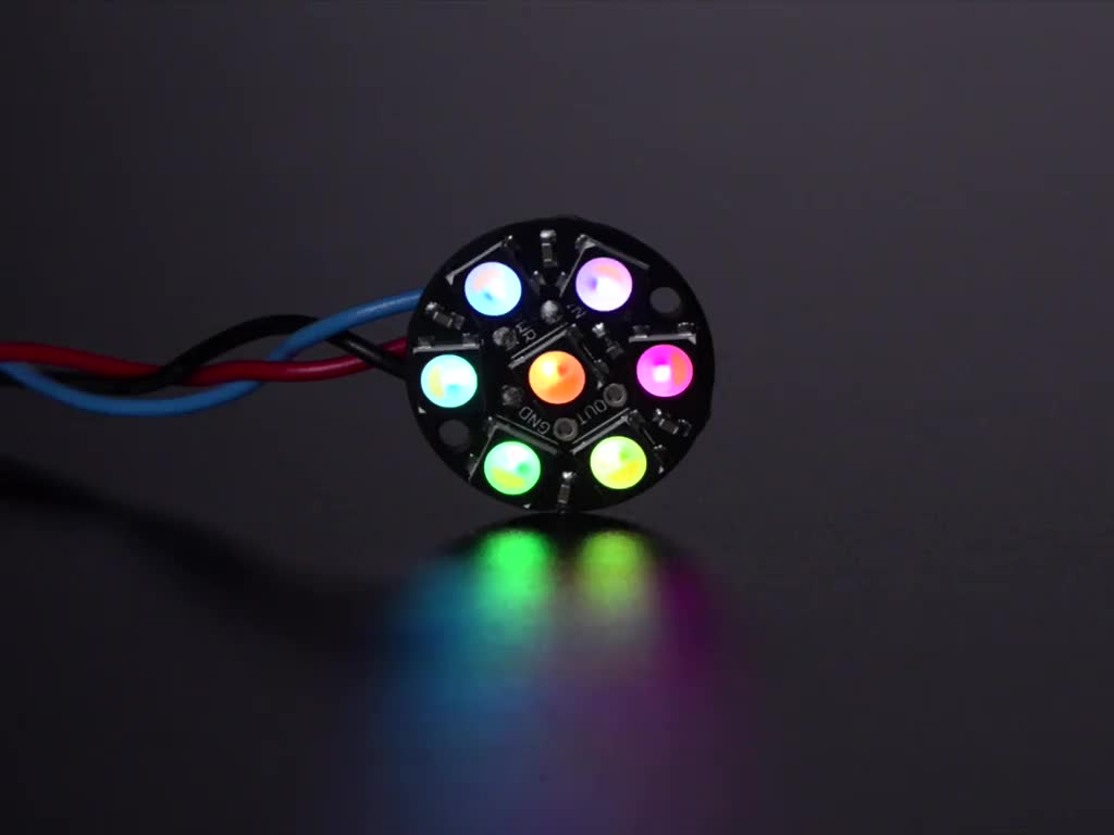 NeoPixel Jewel - 7 x 5050 RGB LED wired to Trinket, lit up rainbow and white