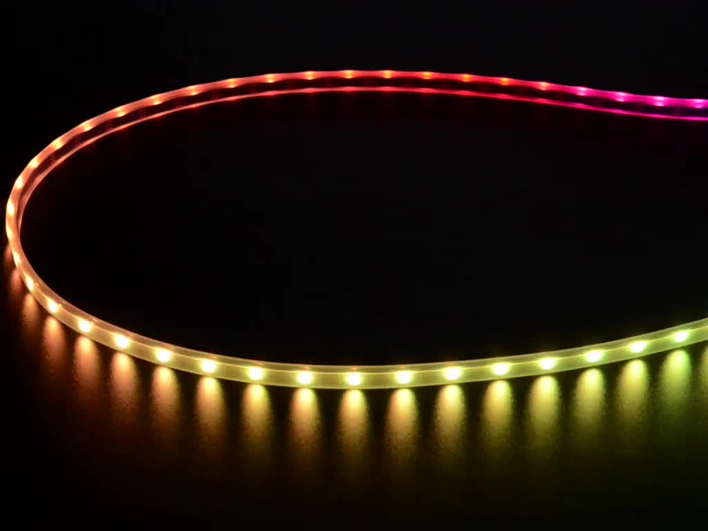 Adafruit NeoPixel Digital RGB LED Strip wired to a microcontroller, with all the LEDs in a rainbow