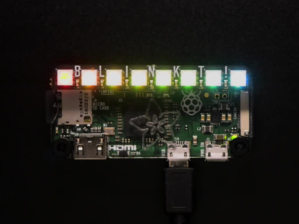PCB plugged into Raspberry Pi Zero and swirling LED colors
