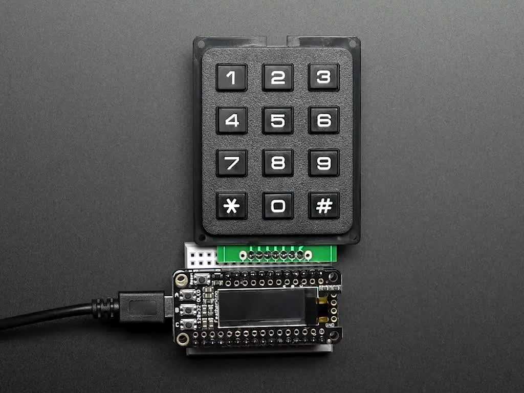 3x4 Keypad wired to Feather, finger types out 867-5309