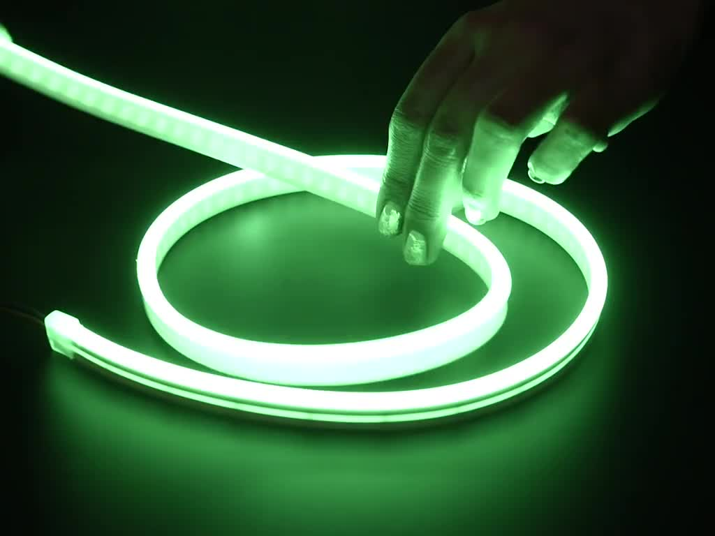 Two hands repeatedly bending and manipulating lit-up flexible silicone tubing.