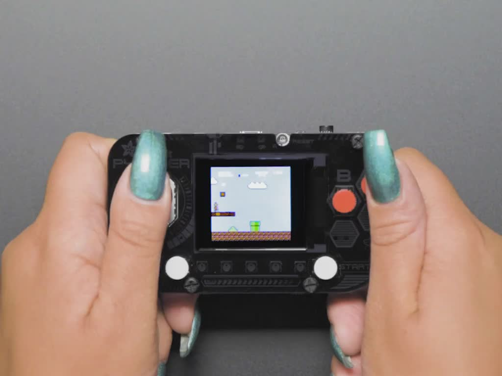 Person playing Super Mario game on PyGamer
