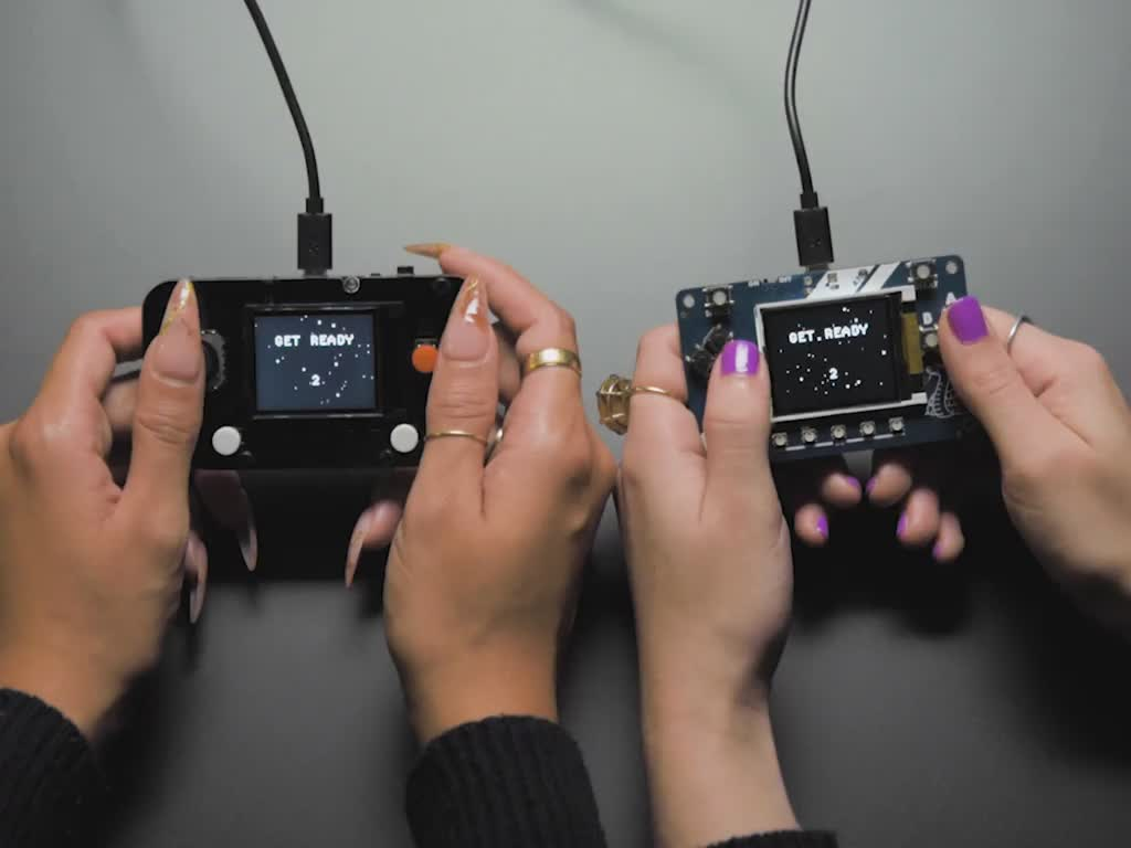Cable is connecting two game devices together for multiplayer use.