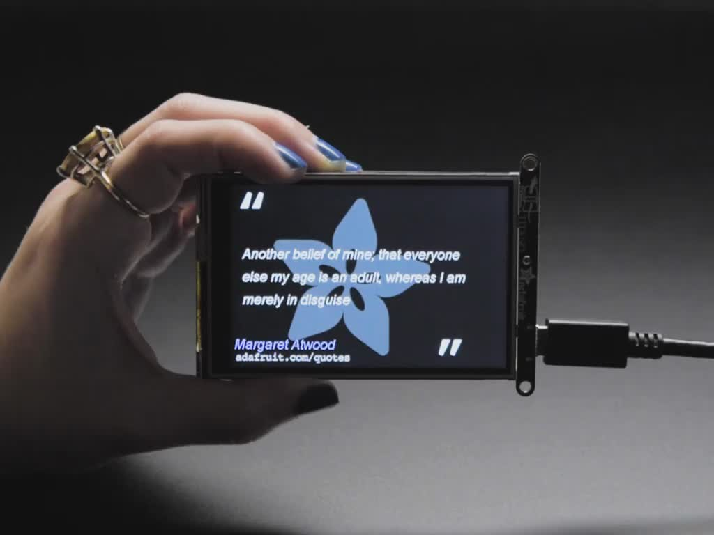Animation showing PyPortal displaying inspirational quotes.