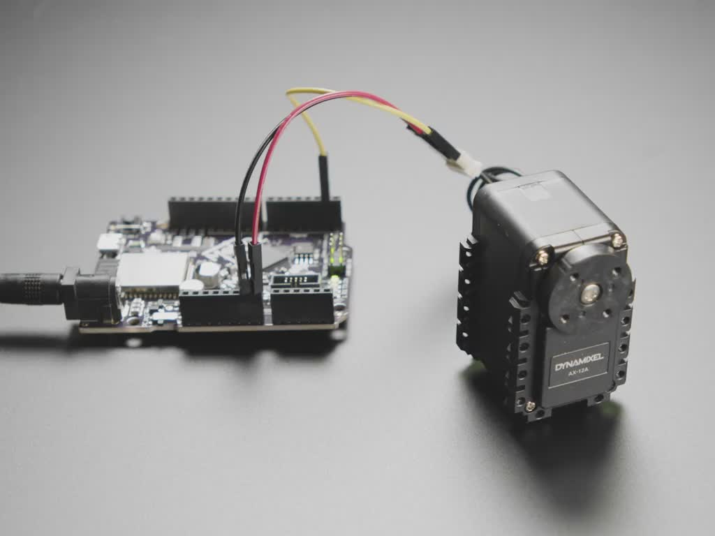 Motor wired to Arduino, slowly turning forward and back