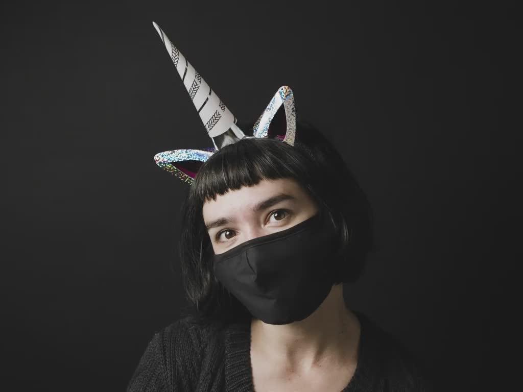 Woman with assembled DIY Be a Unicorn Light-Up Unicorn Headband Kit posing