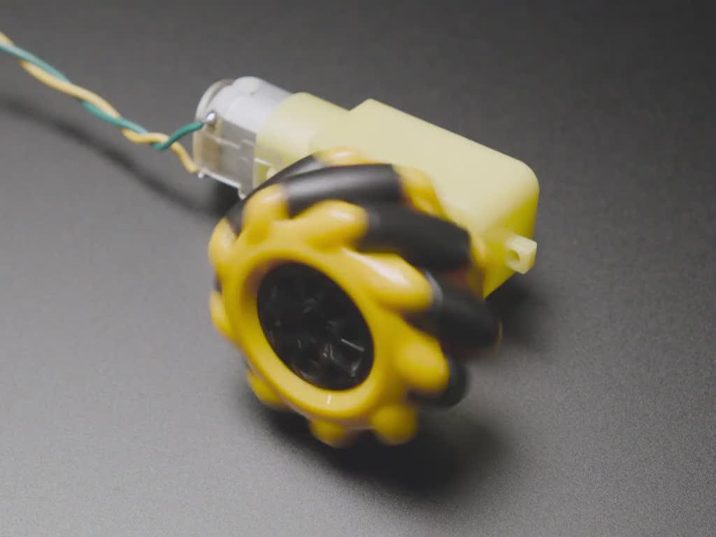 Angled video of a mecanum wheel running on a TT motor.