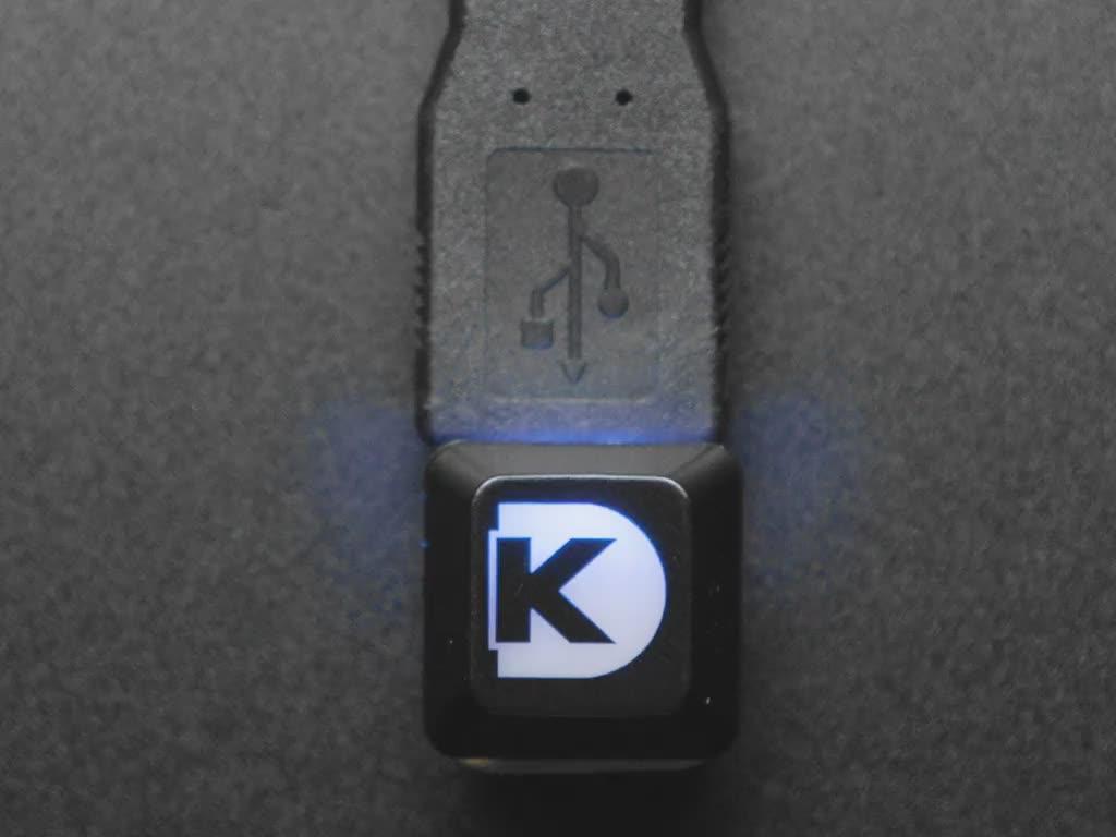 Top view video of a Digi-Key keycap glowing rainbow colors via an Adafruit NeoKey Trinkey NeoPixels.