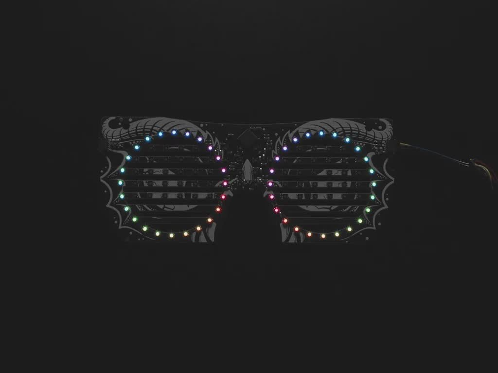 Top view of dragon eyeglass PCB. ADAFRUIT in rainbow LEDs scrolls across the mask.
