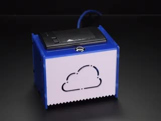 Square acrylic box with cloud sign on front, with receipt paper coming out with text on it.