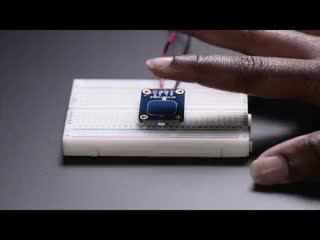 Finger slowly touching sensor pad, LED lights up when touched.