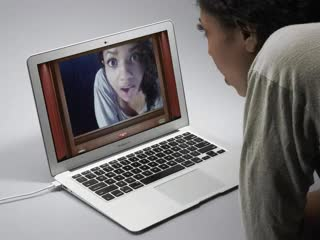 This shows small clips of a woman in front of her laptop covering the camera part of the laptop with a small eye image sticker.