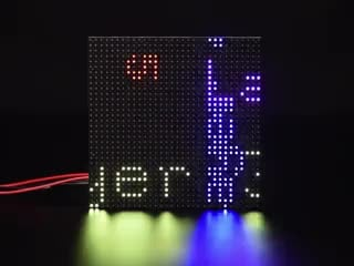 LED matrix with colorful text scrolling by in mulitple directions and speeds
