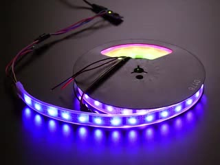 Coiled LED strip with each LED glowing through a rainbow swirl