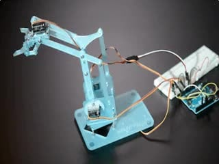 Robot arm moving around and opening/closing the grabber.