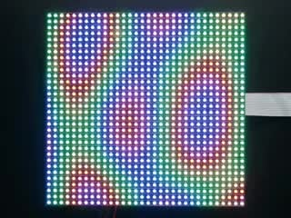 Video of assembled and powered on 32x32 RGB LED Matrix Panel - 5mm pitch. The matrix displays swirling, psychedelic rainbow colors.