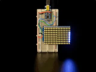 """Soldered and assembled 16x8 1.2"""" LED Matrix + Backpack - Ultra Bright Round White LEDs on a breadboard powered by a trinket. The LED Matrix displays the rolling text: """"Adafruit"""""""