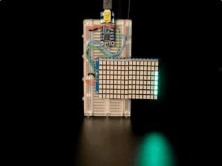 """Soldered and assembled 16x8 1.2"""" LED Matrix + Backpack - Ultra Bright Square Green LEDs on a breadboard powered by a trinket. The LED Matrix displays the rolling text: """"Adafruit"""""""