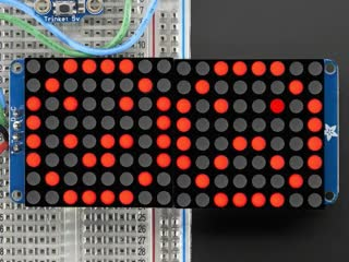 """Animation of close-up of soldered and assembled 16x8 1.2"""" LED Matrix + Backpack - Ultra Bright Round LEDs on a breadboard. The LED Matrices display a smiling emoji and a frowning emoji in different colors."""