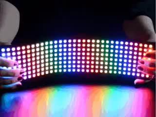 Video of two hands bending a Flexible 8x32 NeoPixel RGB LED Matrix.
