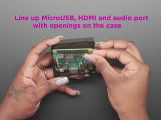 Video of a Black woman's hands assembling a Raspberry Pi A+ into an acrylic enclosure.