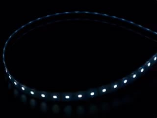 Coiled LED strip with LEDs changing color throughout rainbow and also white