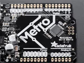 Animation of someone using Chip Quick to remove a large chip from Adafruit Metro