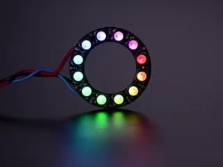 NeoPixel Ring with 12 x 5050 RGBW LEDs lighting up rainbow and white