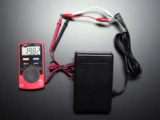 Hand pressing foot pedal, showing change in resistance on multimeter